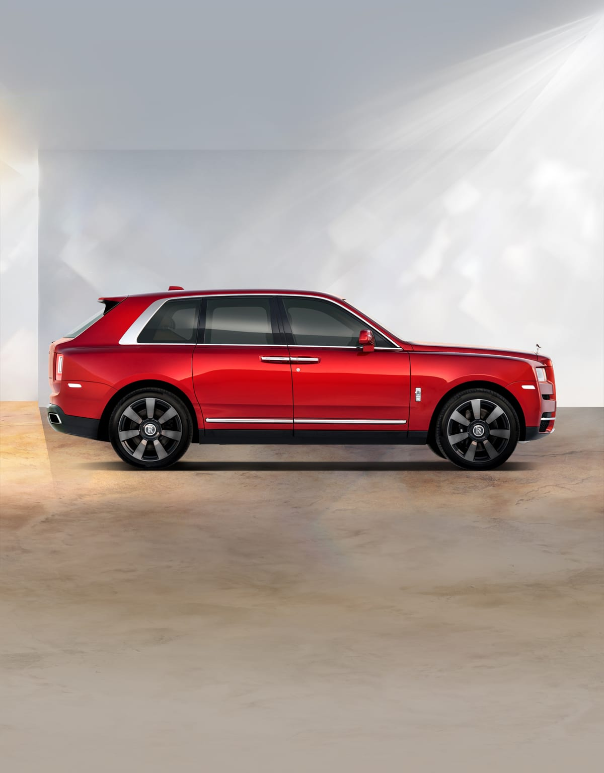Side profile exterior of Rolls-Royce Cullinan motor car.