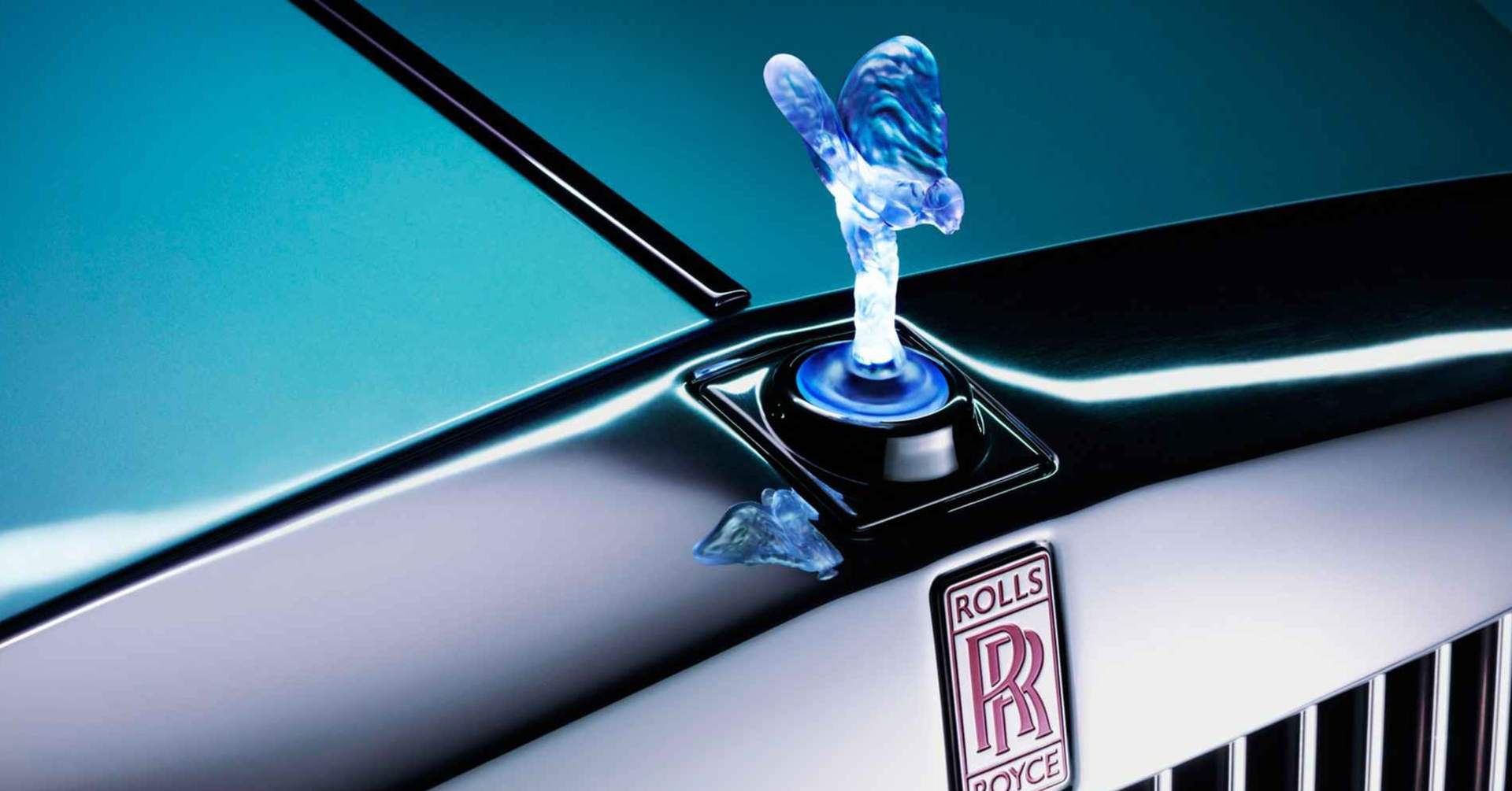 Close-up of a bespoke Spirit of Ecstasy and Rolls-Royce motor cars logo on a prototype electric vehicle.
