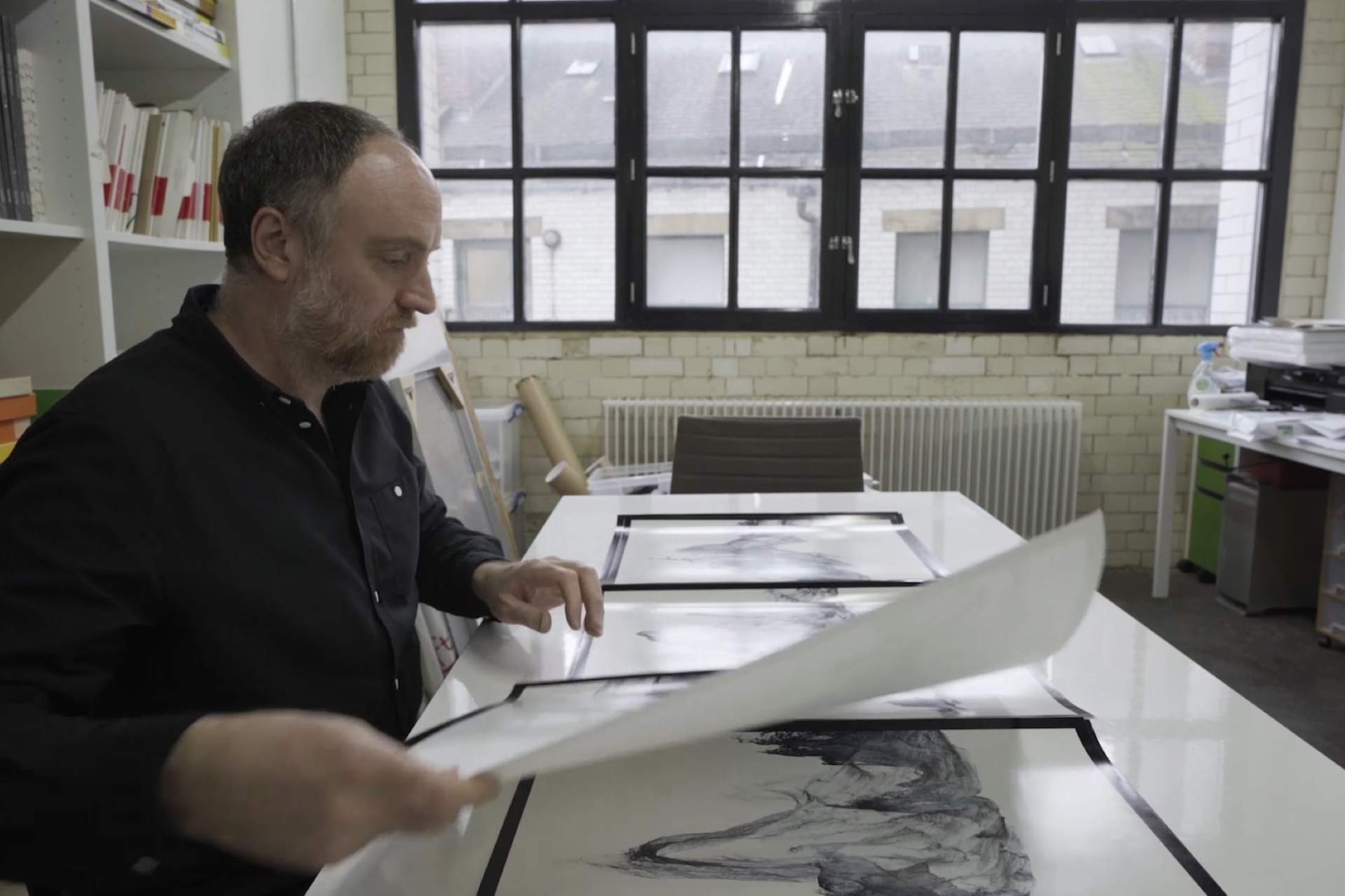 Artist Dan Holdsworth in his studio working on his glacier photographic art project.