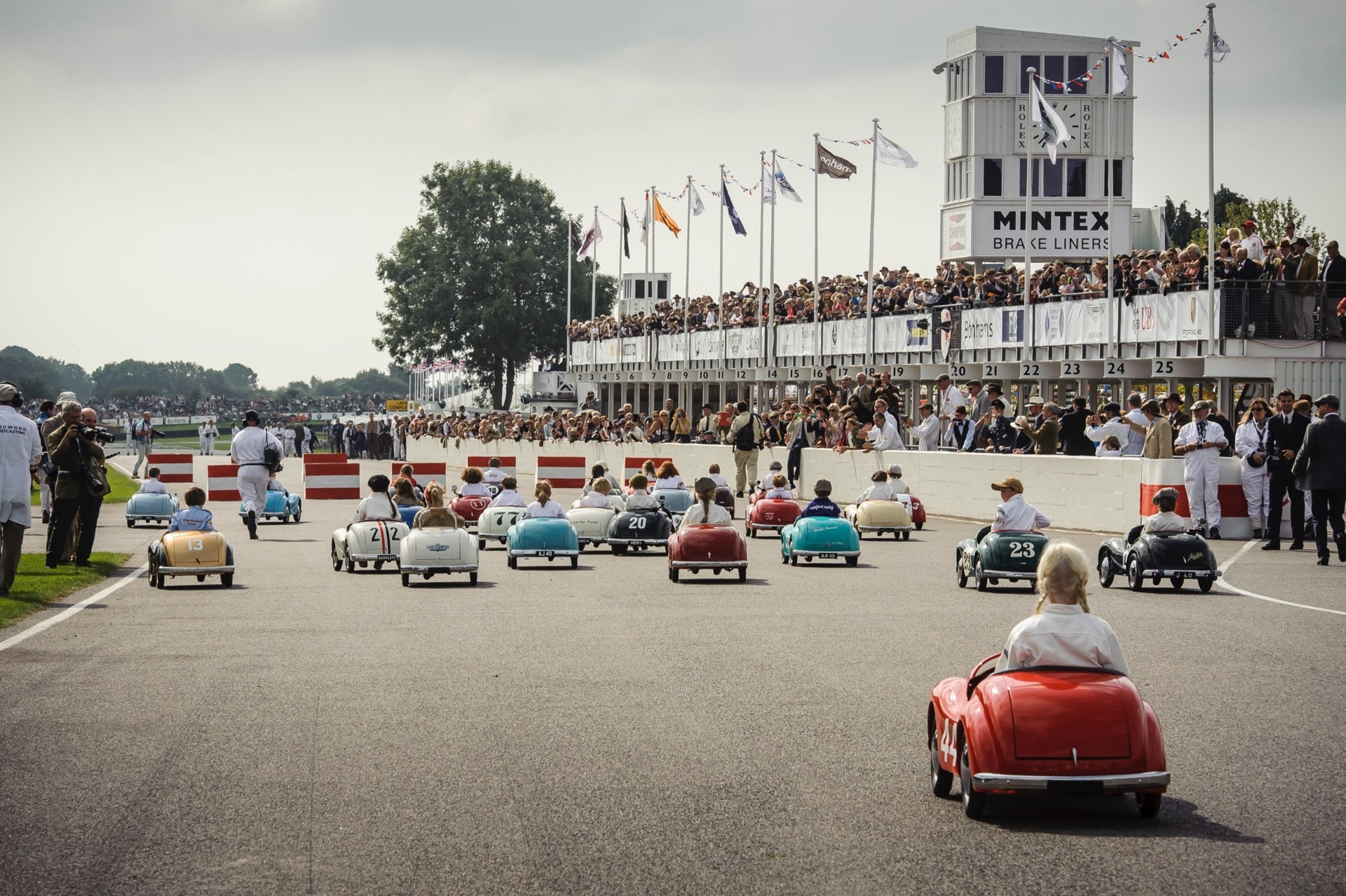 Children racing at the Rolls-Royce Goodwood Revival experience.