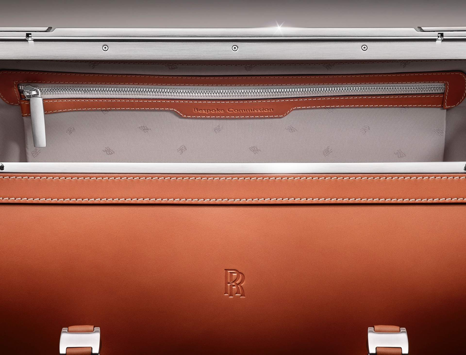 A piece from the Phantom Luggage collection. The picture showcases the small details of the bag, including the leather embossing and the RR monogram embroidery inside the bag.