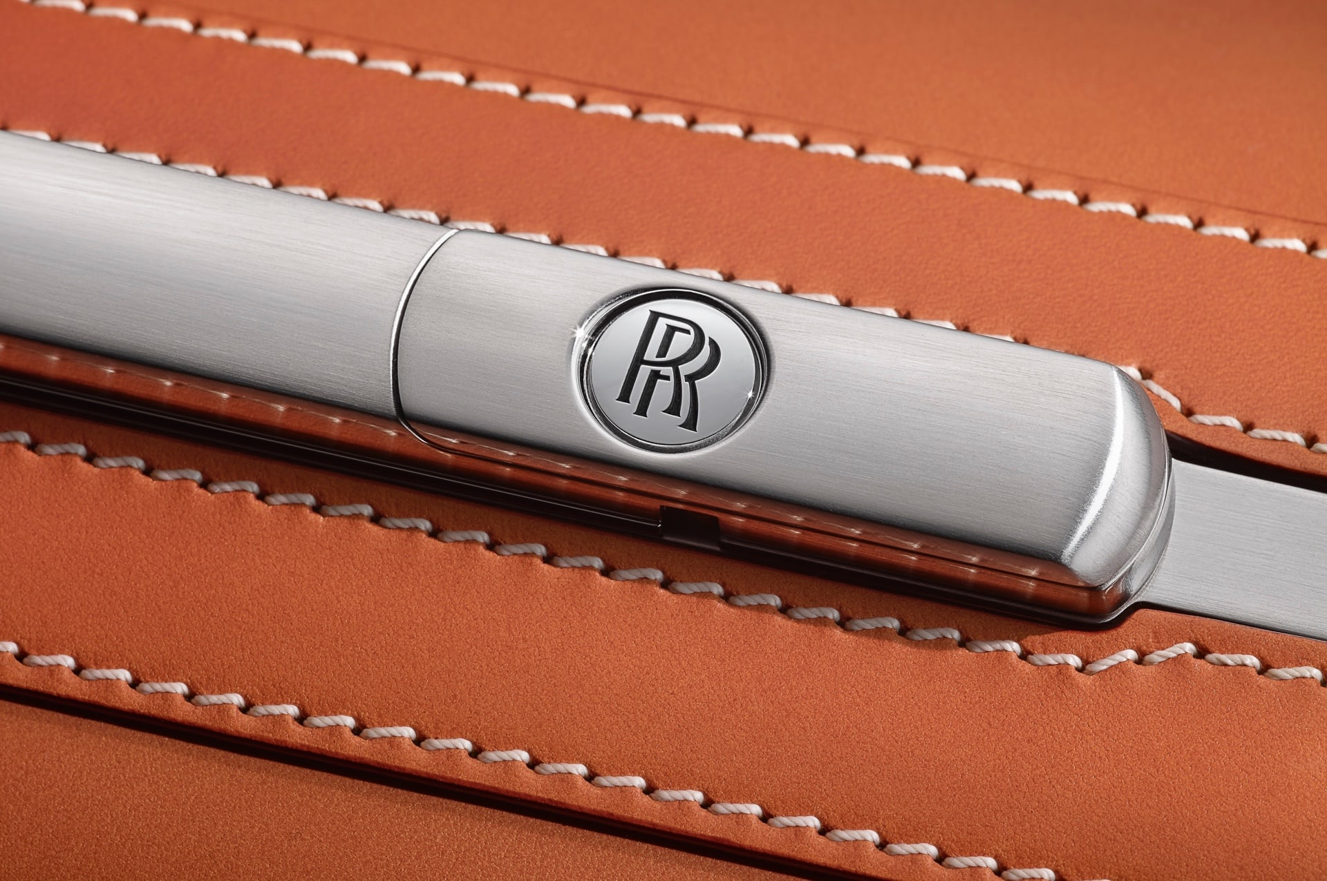 A closeup of the leather and metallic details on the handcrafted Rolls-Royce Phantom Luggage