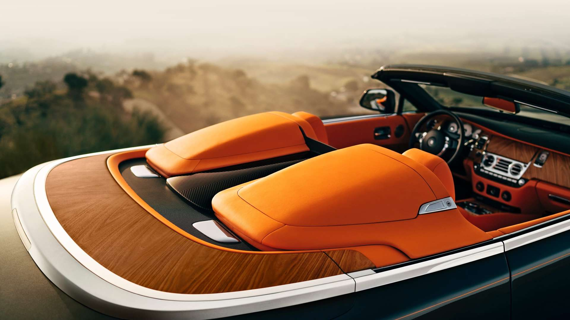 A close up of the orange leather interior on a convertible Rolls-Royce Dawn
