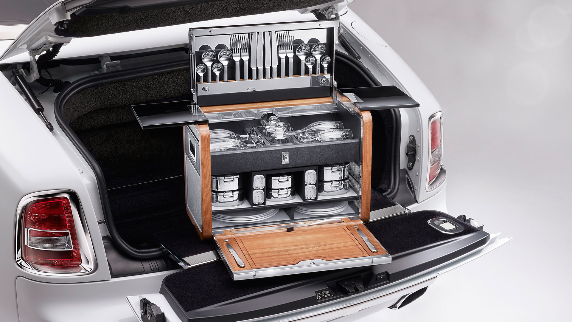 The Rolls-Royce Picnic Hamper in the boot of a light grey Rolls-Royce Phantom