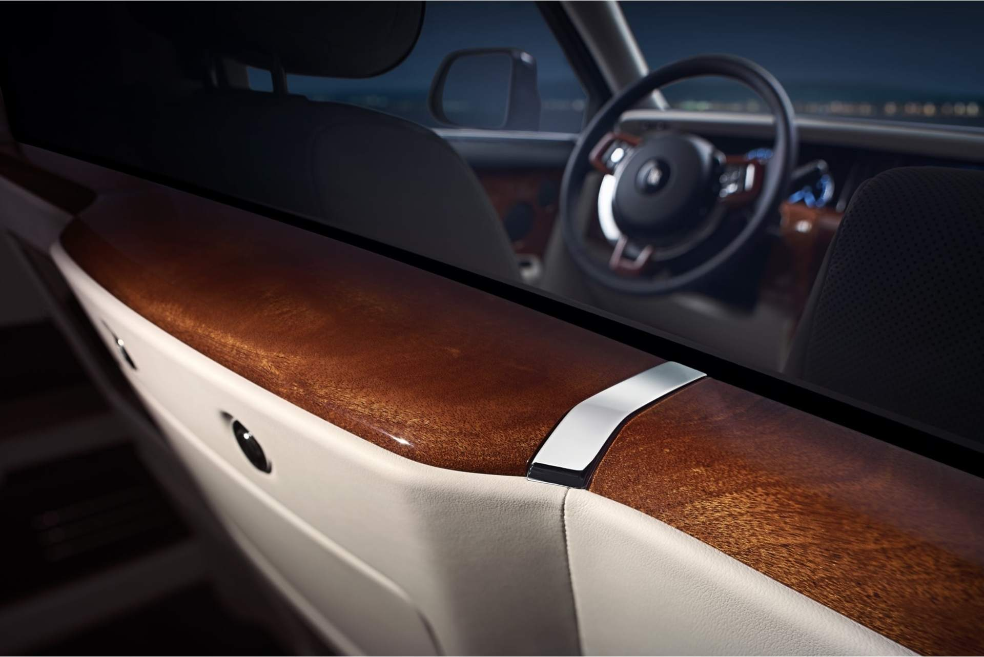 A close up on the wooden detailing and dashboard of the Rolls-Royce Phantom