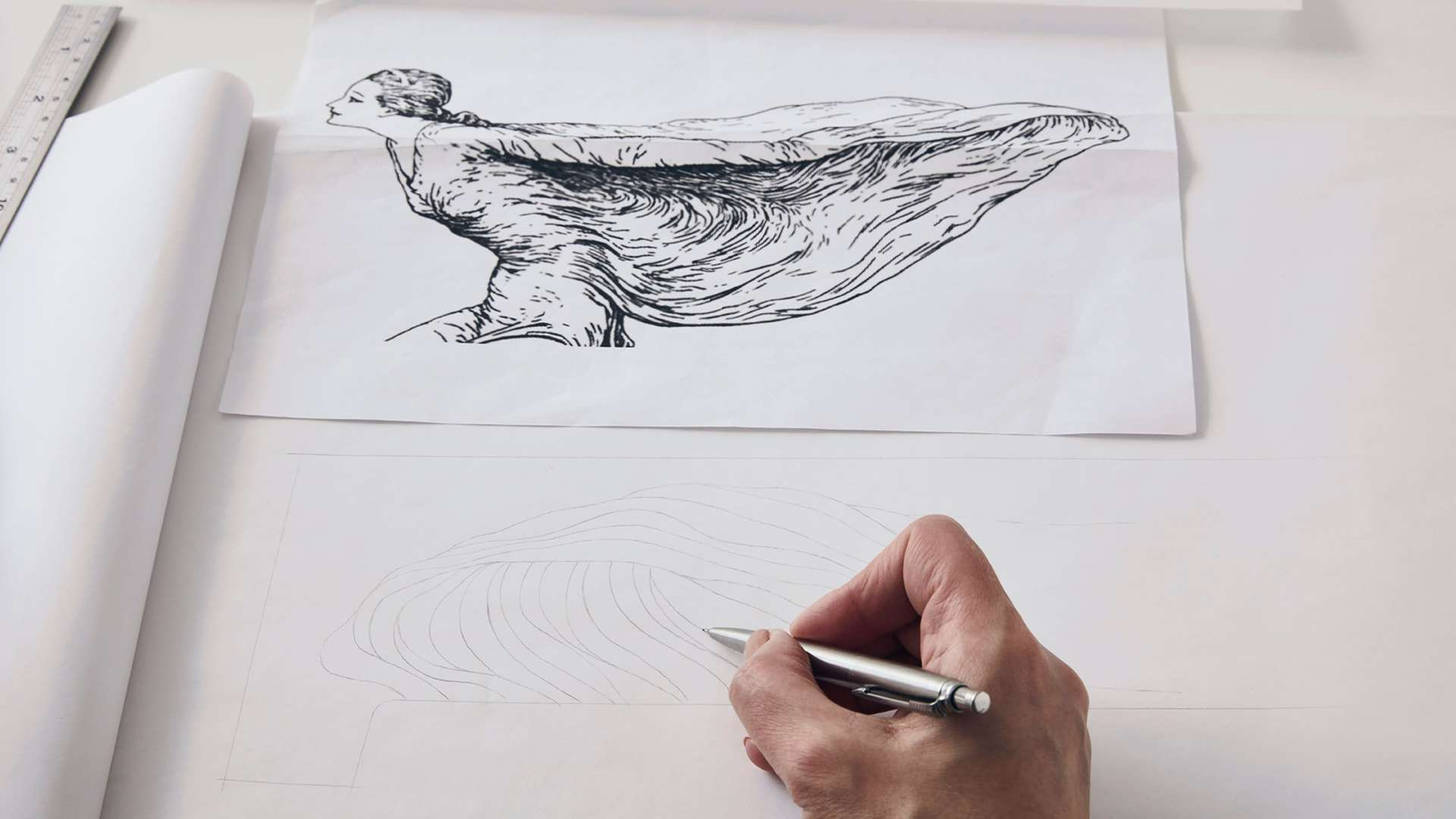An image showing designer Helen Ann Murrey taking inspiration from an old illustration of the Spirit of Ecstasy to create a Phantom Gallery