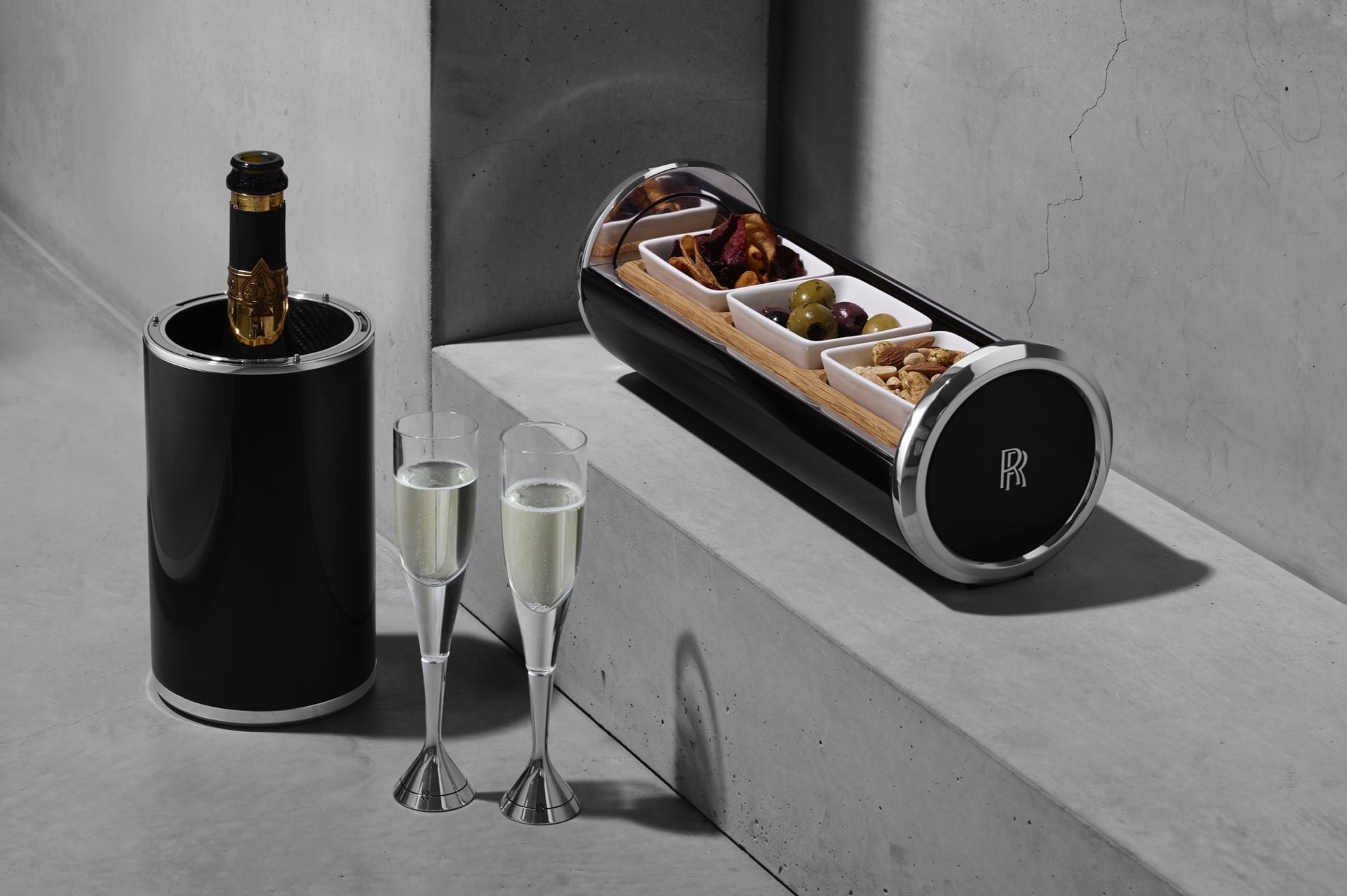 A bespoke thermal champagne cooler and a canapé capsule neighboured by the hand-blown crystal aluminium flutes