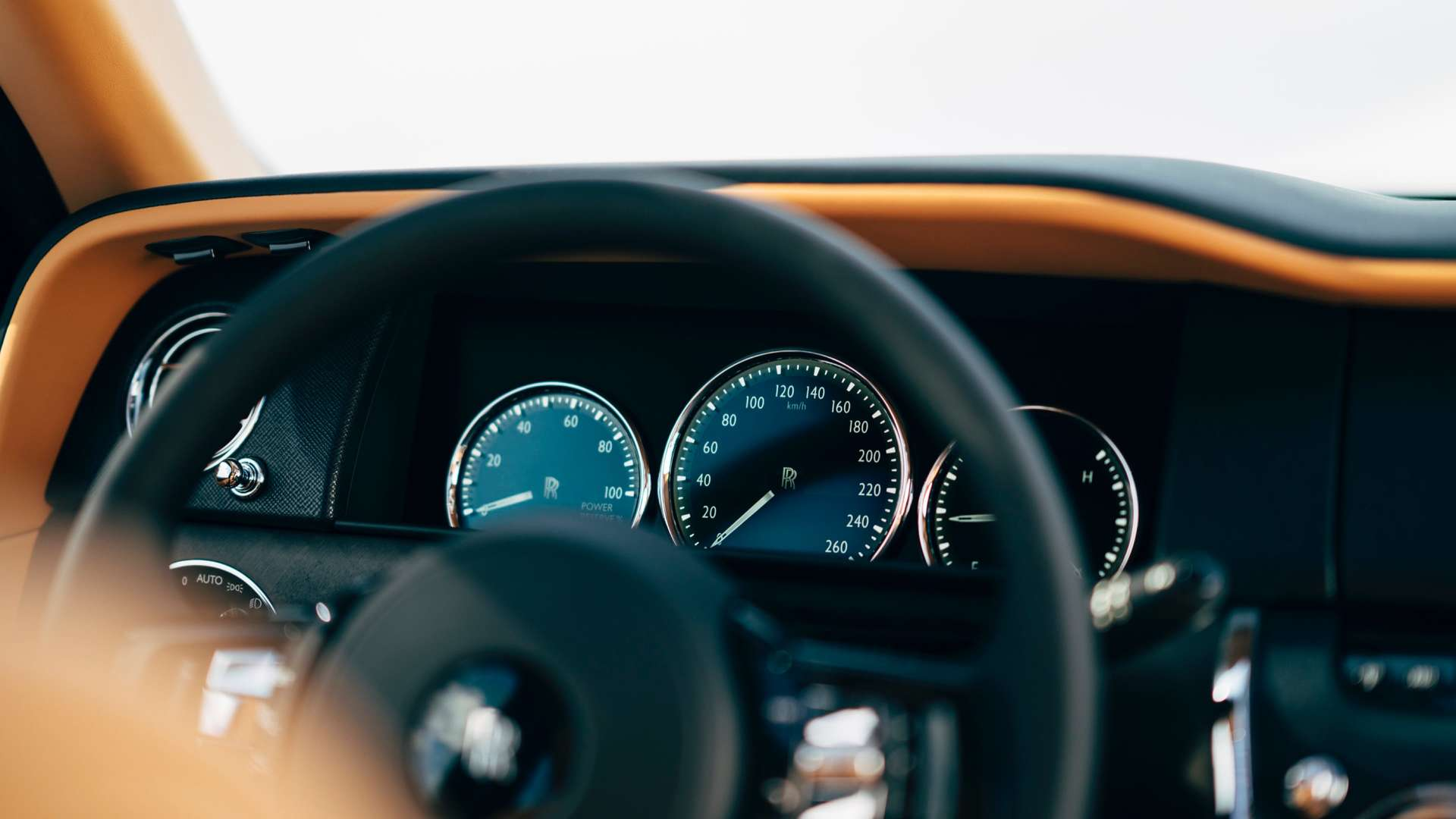 The digital dials of and steering wheel of the Rolls-Royce Cullinan.