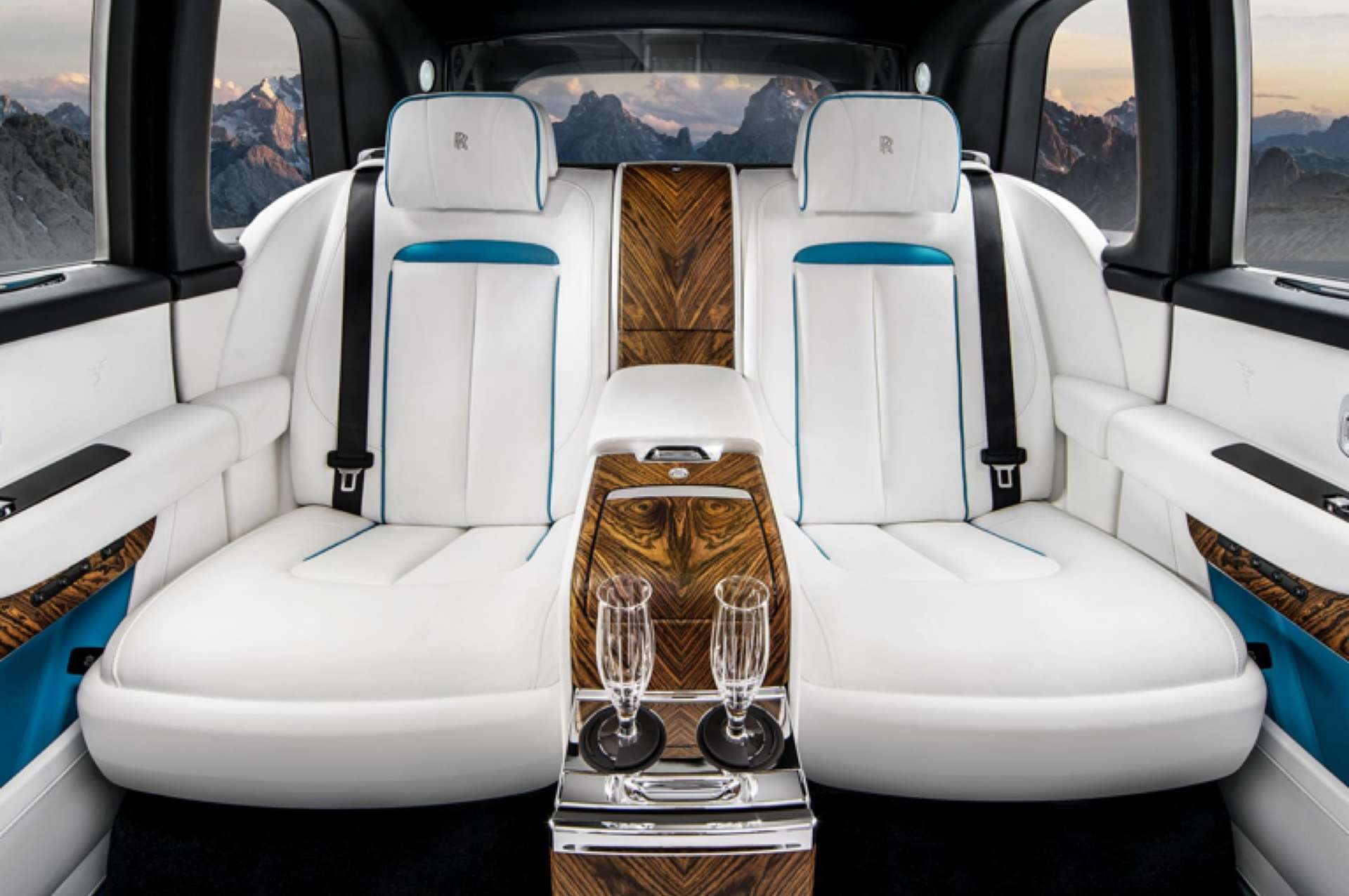 The interior of a Rolls-Royce Cullinan, featuring white leather seating