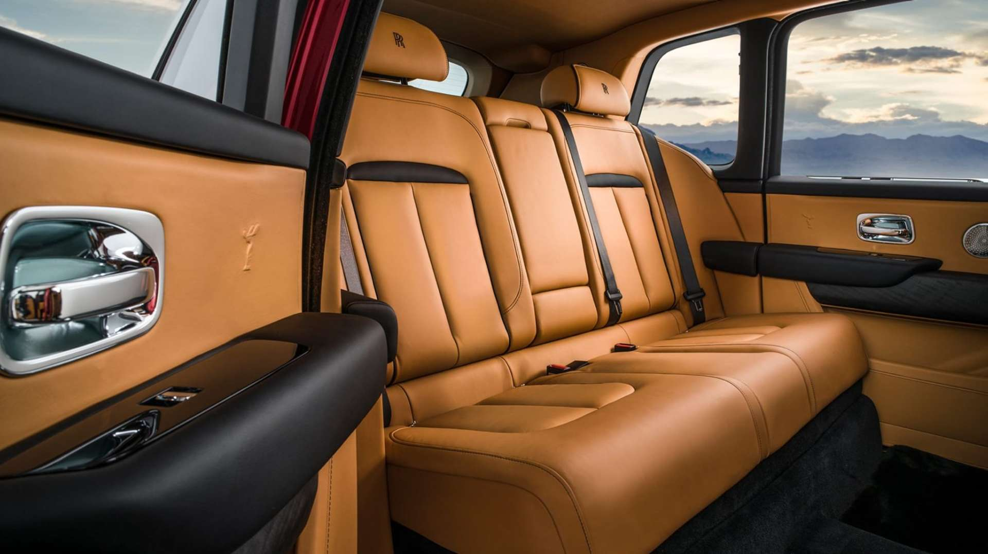The brown leather interior of a Rolls-Royce Cullinan motor car