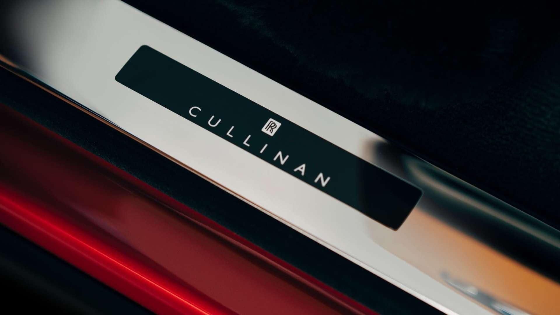 The tread plates on a red Rolls-Royce Cullinan motor car
