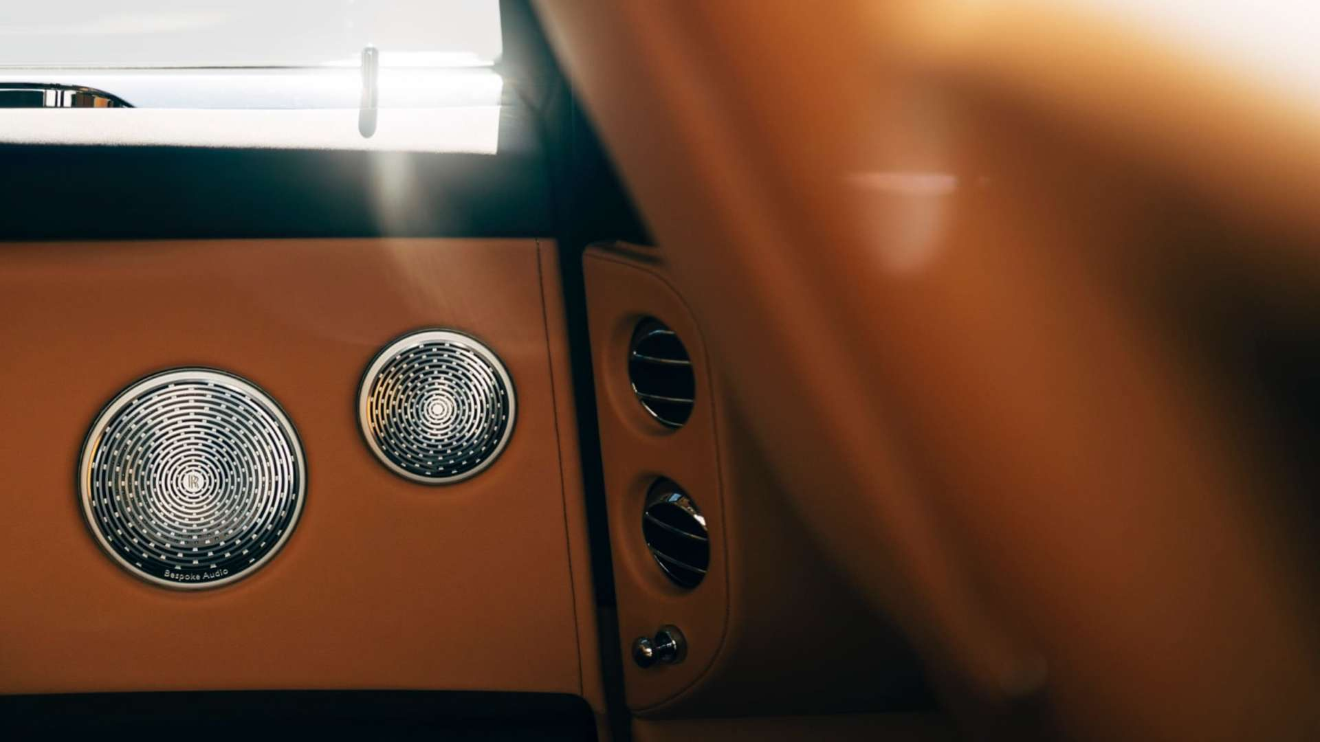 A close up of the audio system in a Rolls-Royce Cullinan motor car