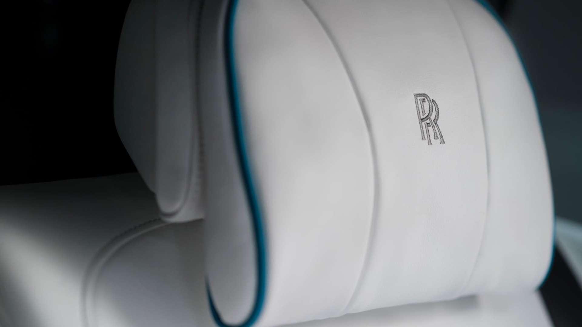 The monogrammed headrest of a Rolls-Royce Cullinan motor car