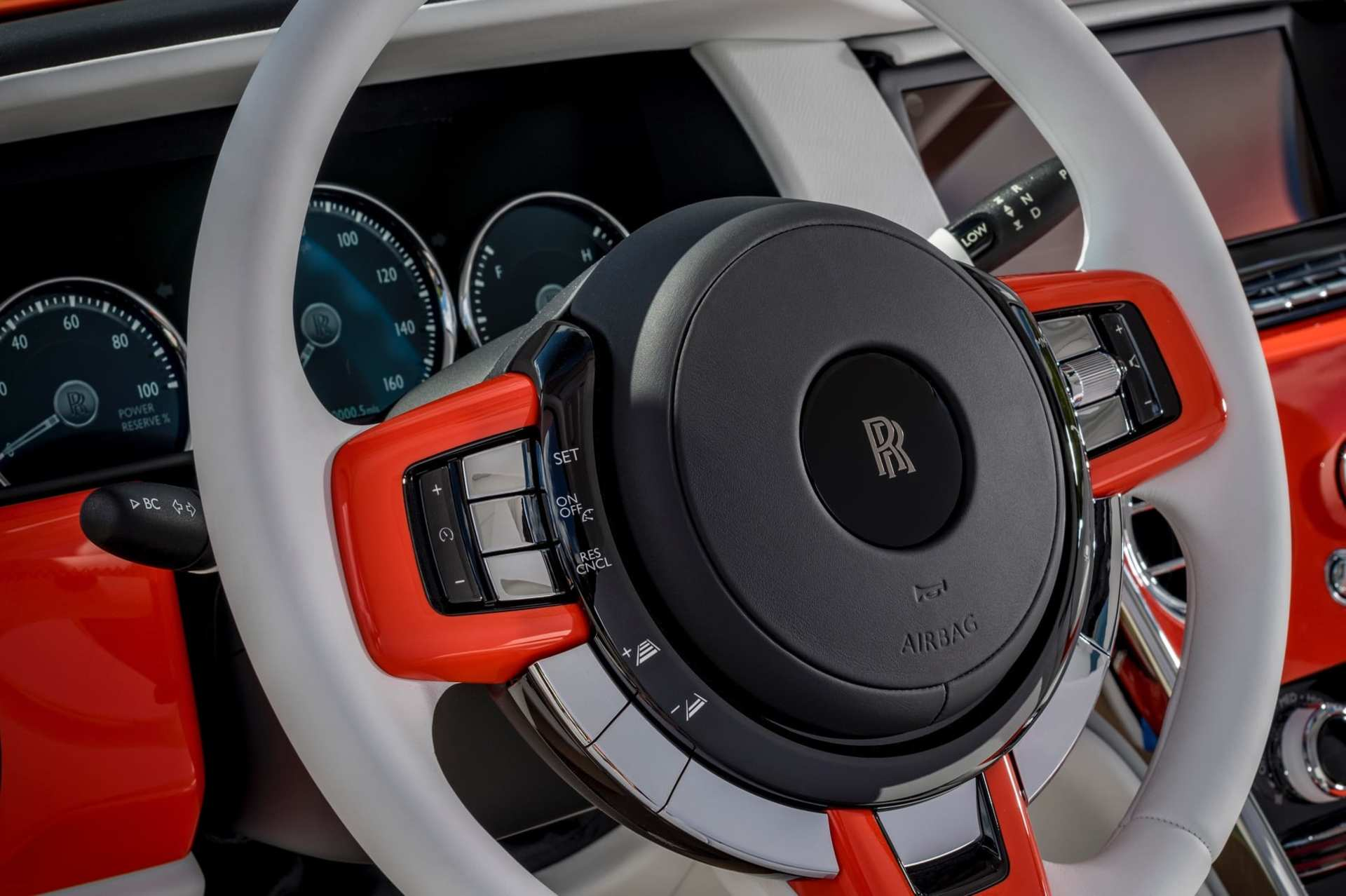The steering wheel of the Bespoke Fux Orange Cullinan Rolls-Royce motor car