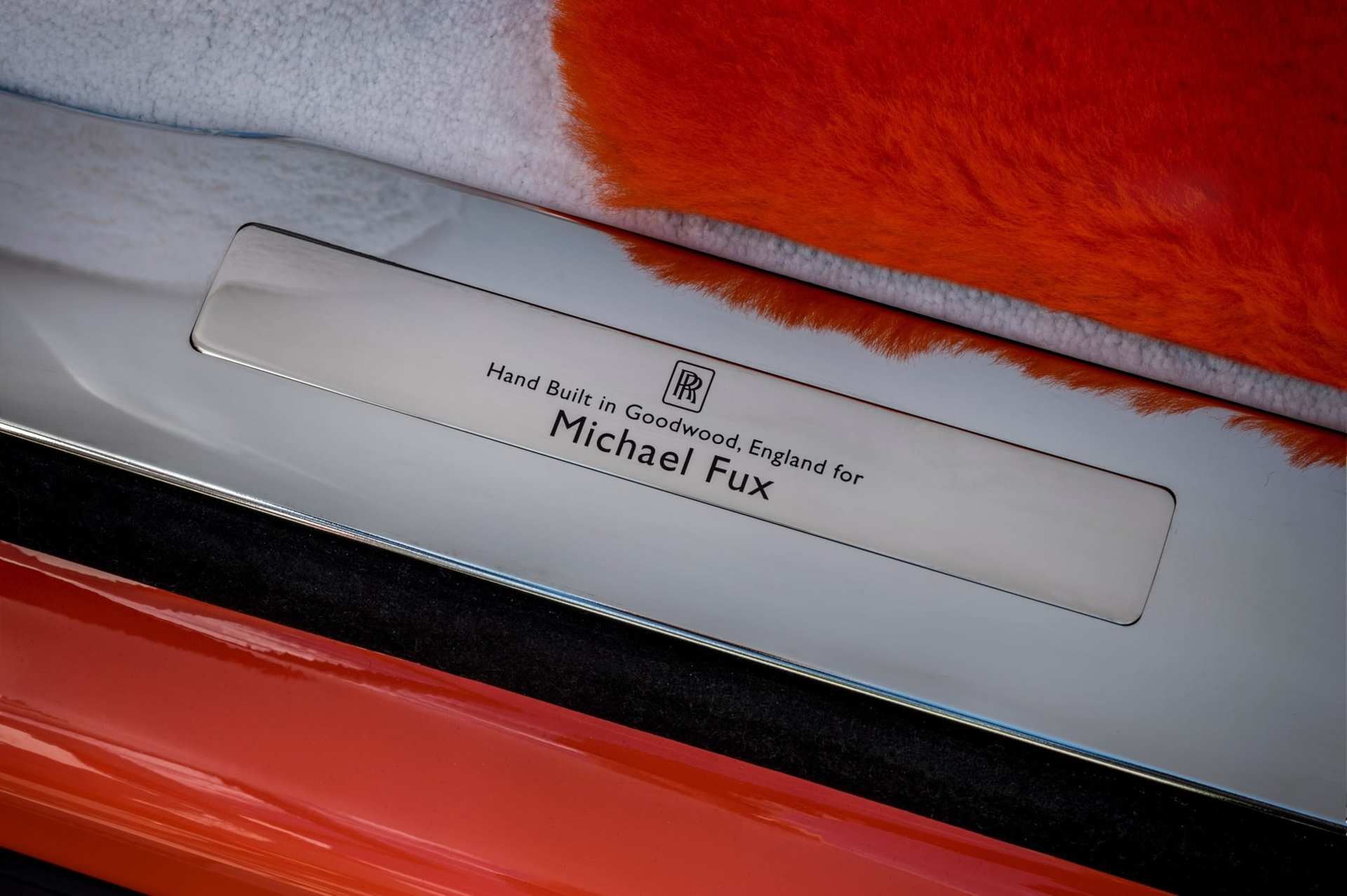 The tread plate of the Bespoke Fux Orange Cullinan Rolls-Royce motor car