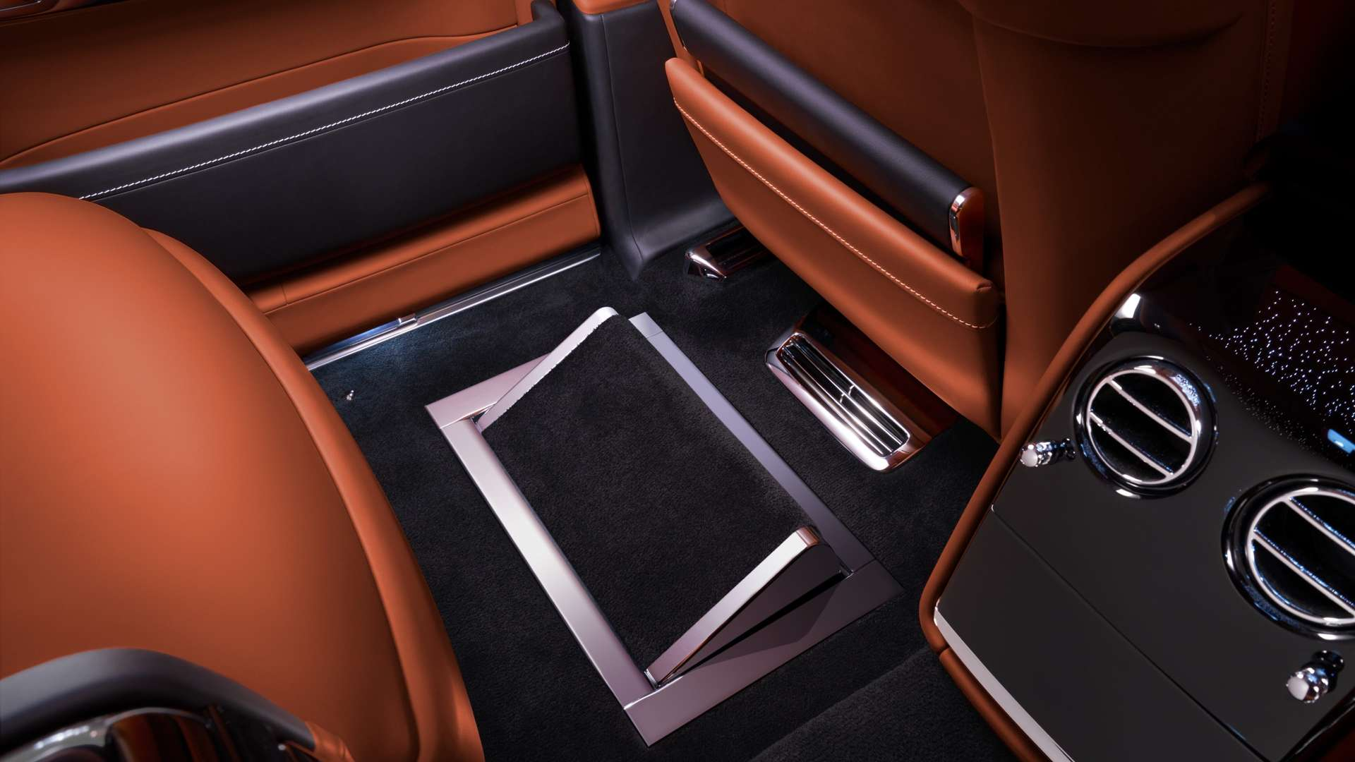 The footrest found in the rear of a Rolls-Royce Phantom.