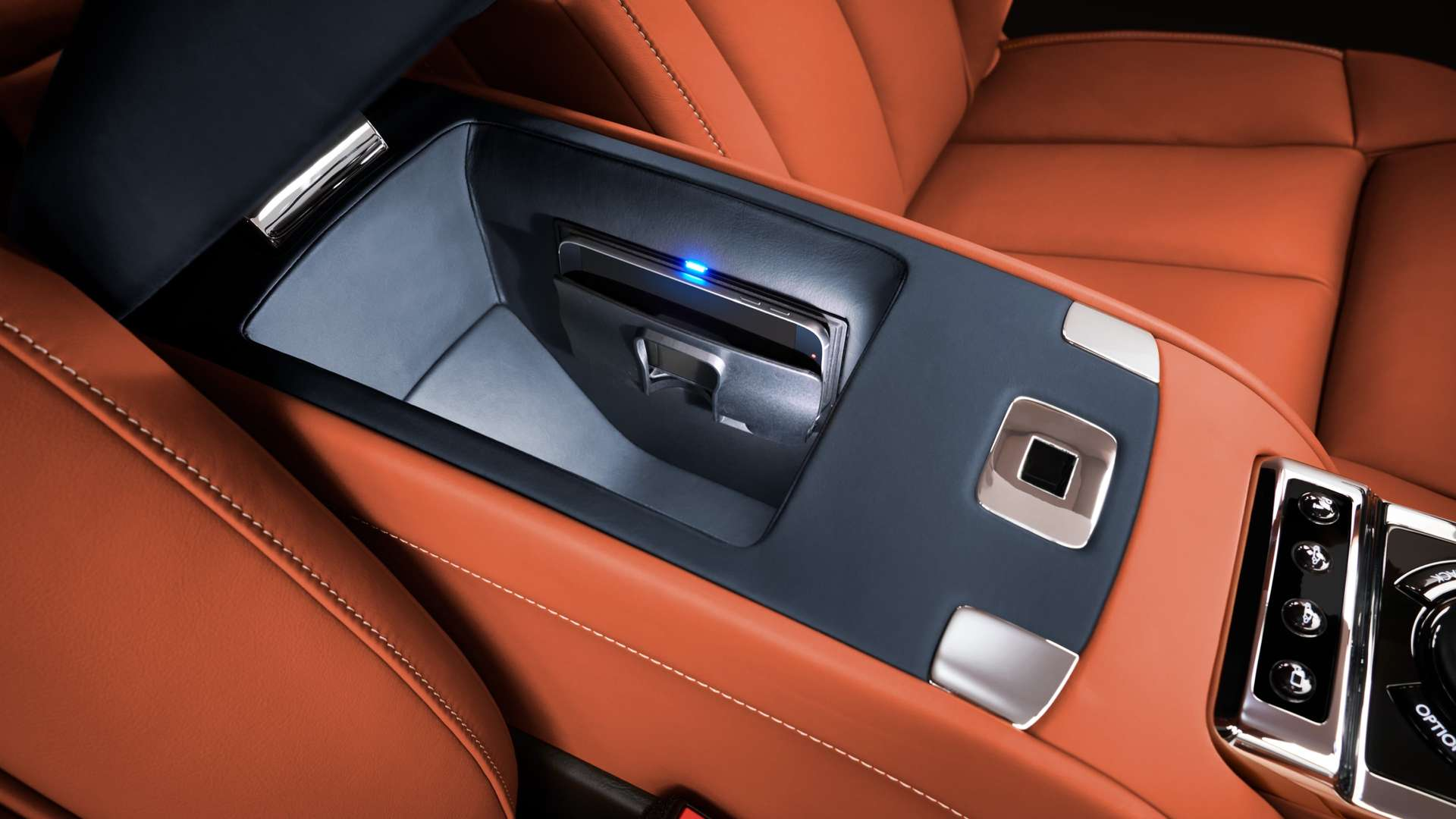 The phone charger in the rear of a Rolls-Royce Phantom.