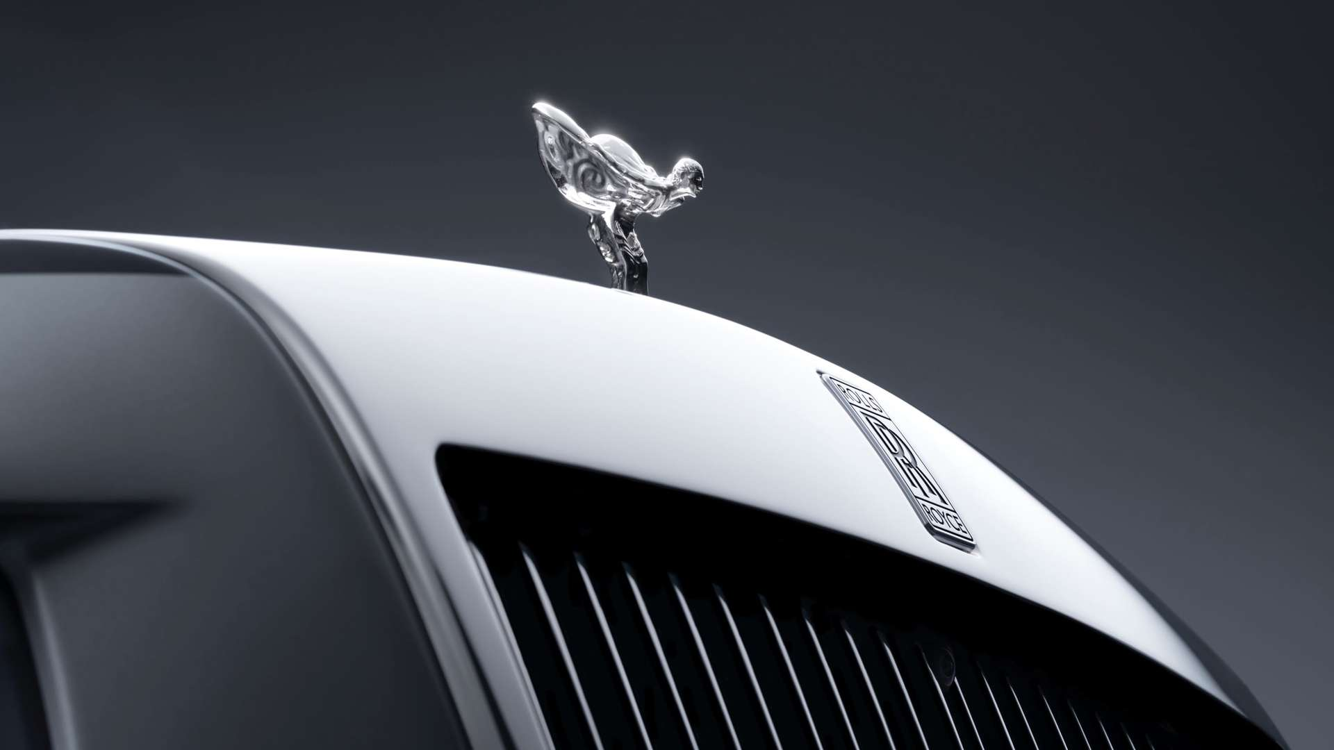 A close up of the Spirit of Ecstasy on the front of a Rolls-Royce Phantom Motor Car