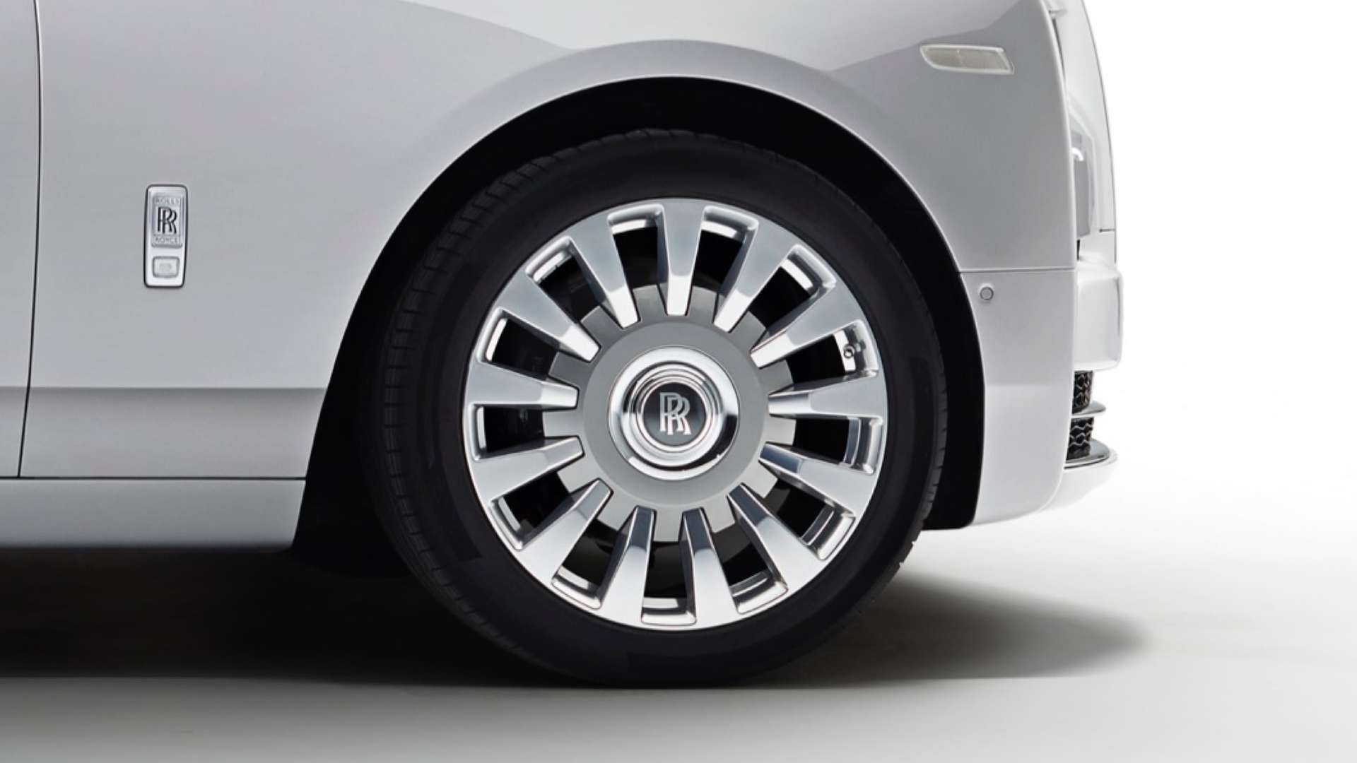 A close up of the wheel of a Rolls-Royce Phantom Motor Car