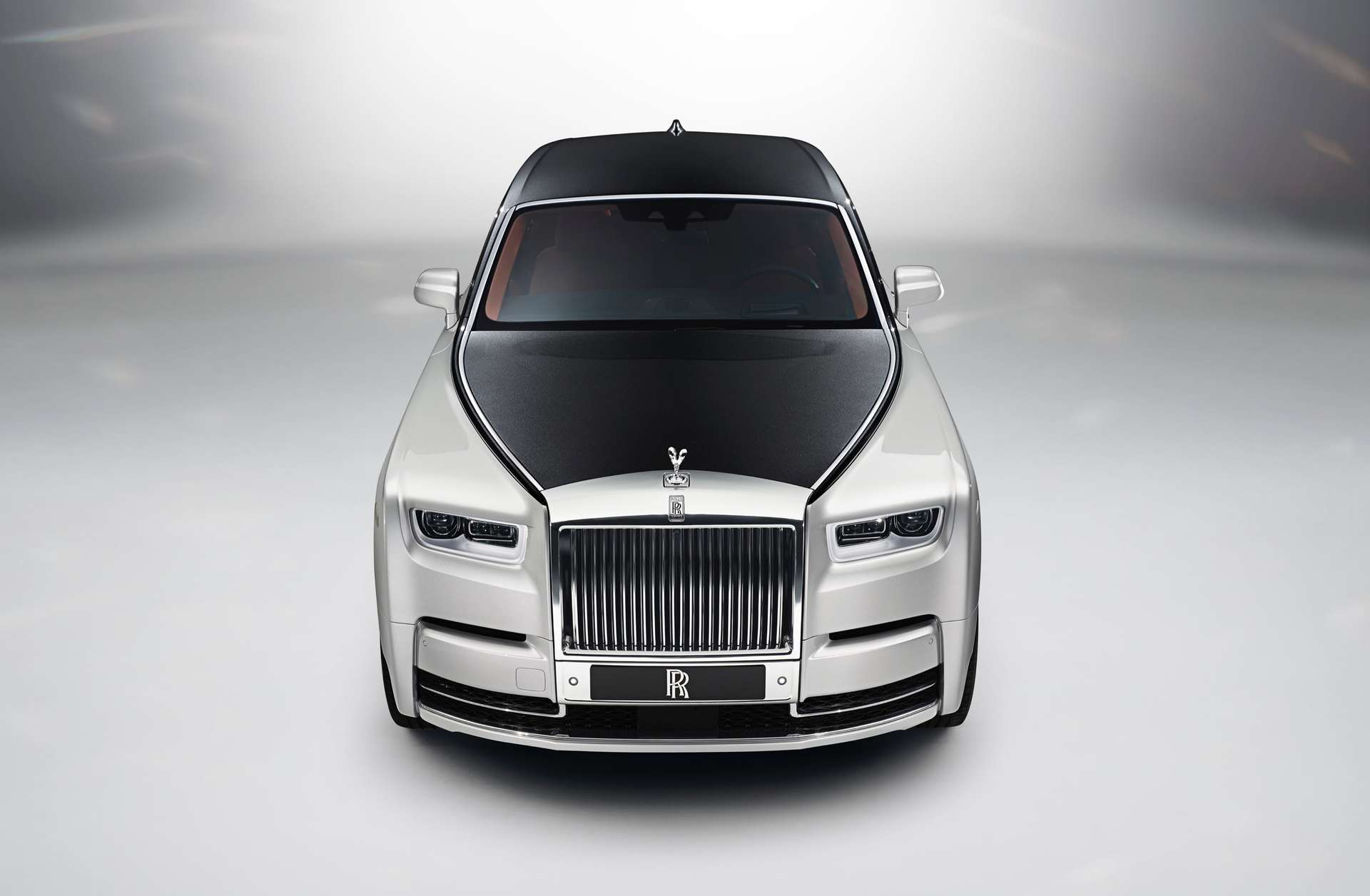 A front on view of a two toned Rolls-Royce Phantom Motor Car