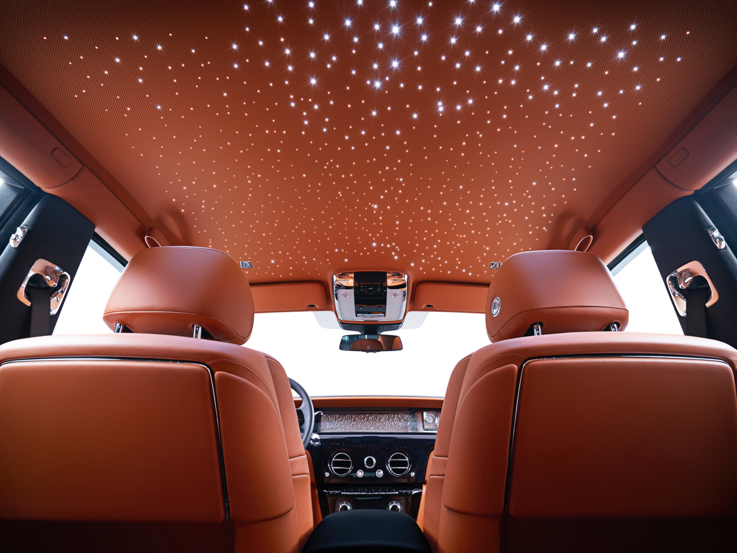 An interior shot of the starlight roof in a Rolls-Royce Phantom motor car