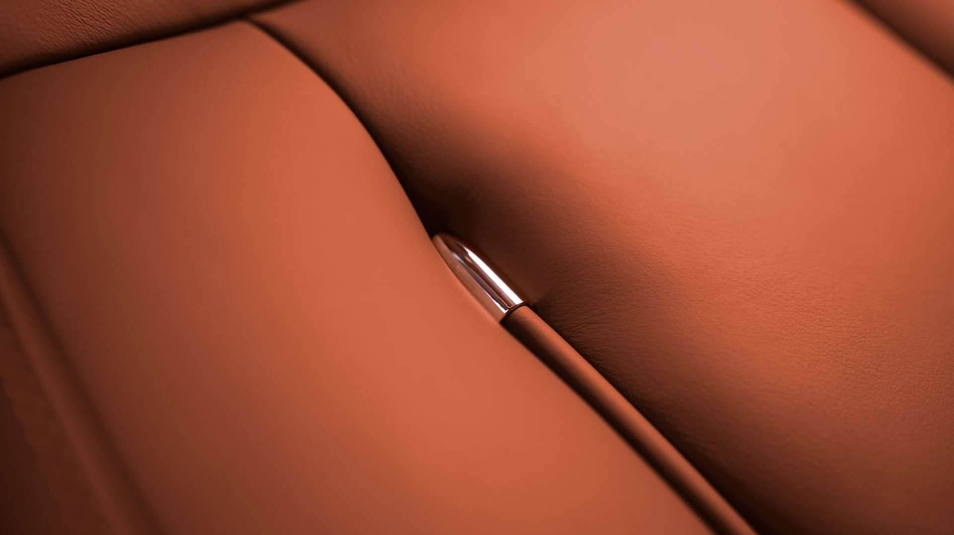 A close up of the leather interior of a Rolls-Royce Phantom Motor Car