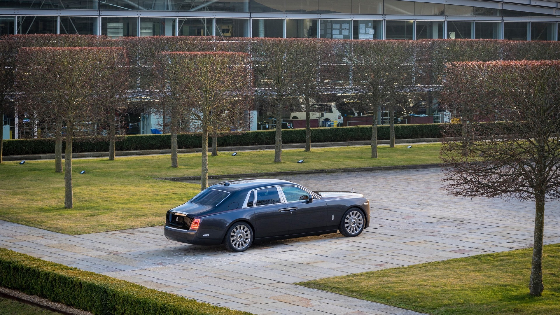 Far away view of gunmetal Rolls-Royce Phantom standard wheelbase