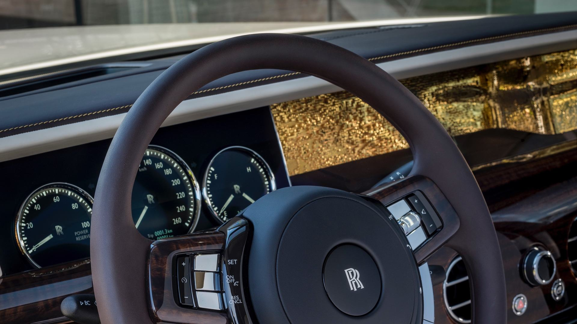 Close up of steering wheel from a Rolls-Royce smokey quartz Phantom