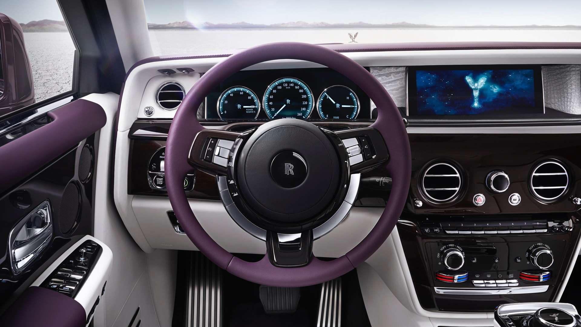 The wheel and dashboard  inside a Rolls-Royce Phantom EWB model