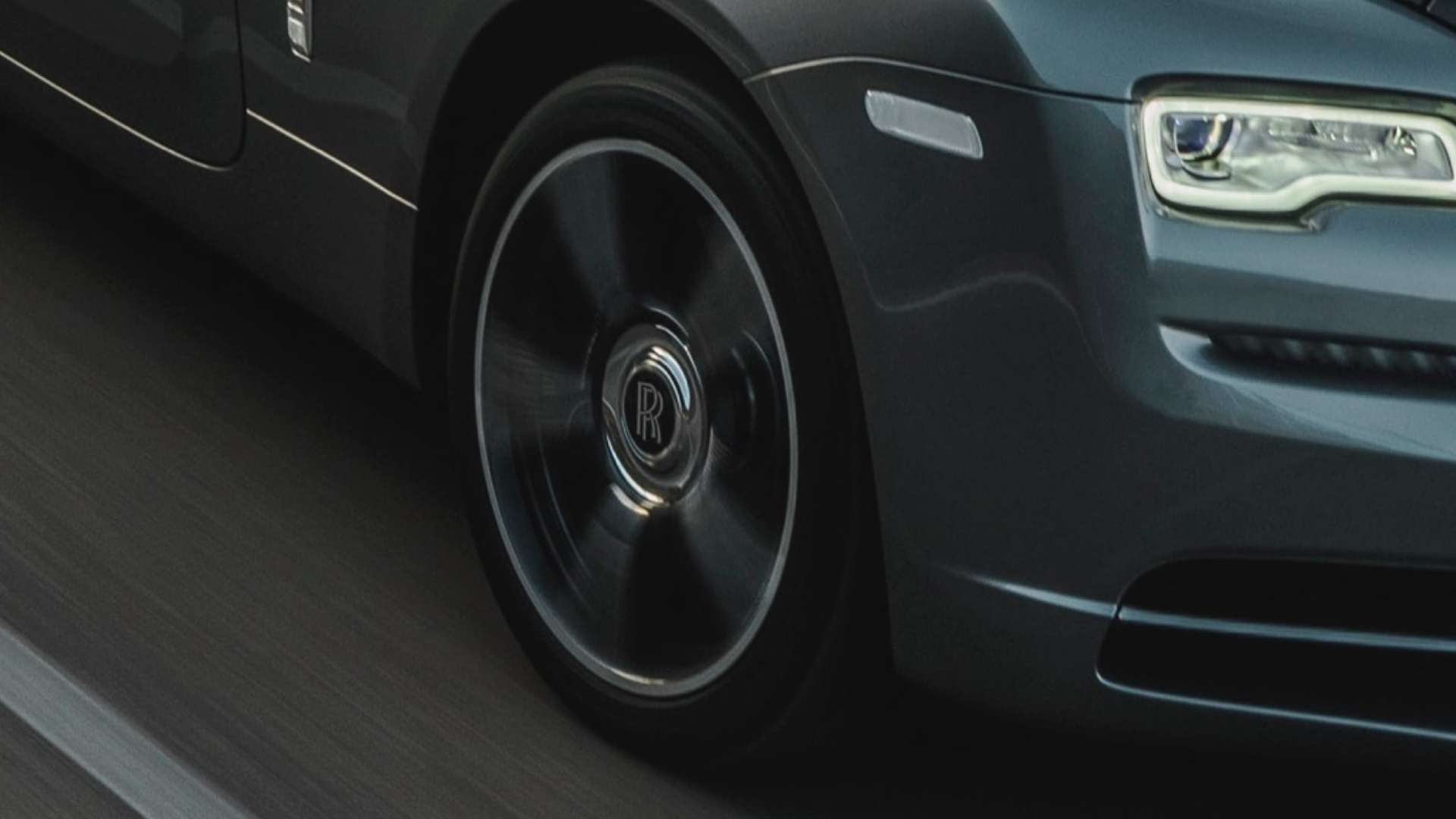 Rolls-Royce Wraith close up of side wheel and left front light, on the road