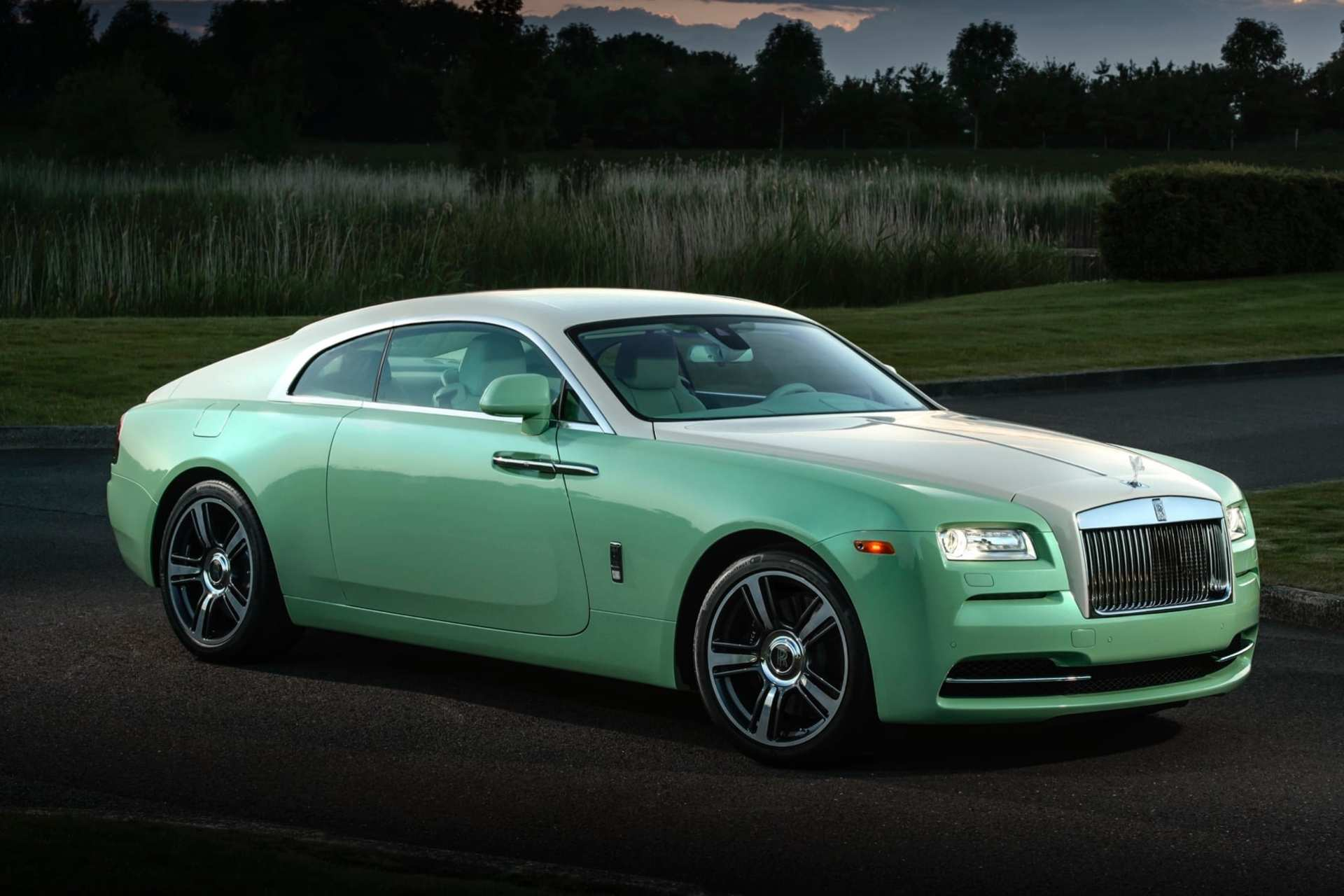 Rolls-Royce Wraith Michael Fux commission, full car profile, wide shot, lime green with grass and dark sky in background