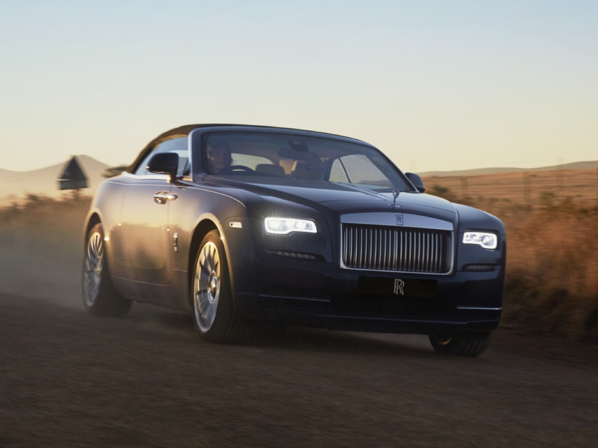 Front view of Rolls-Royce Dawn on a dirt road