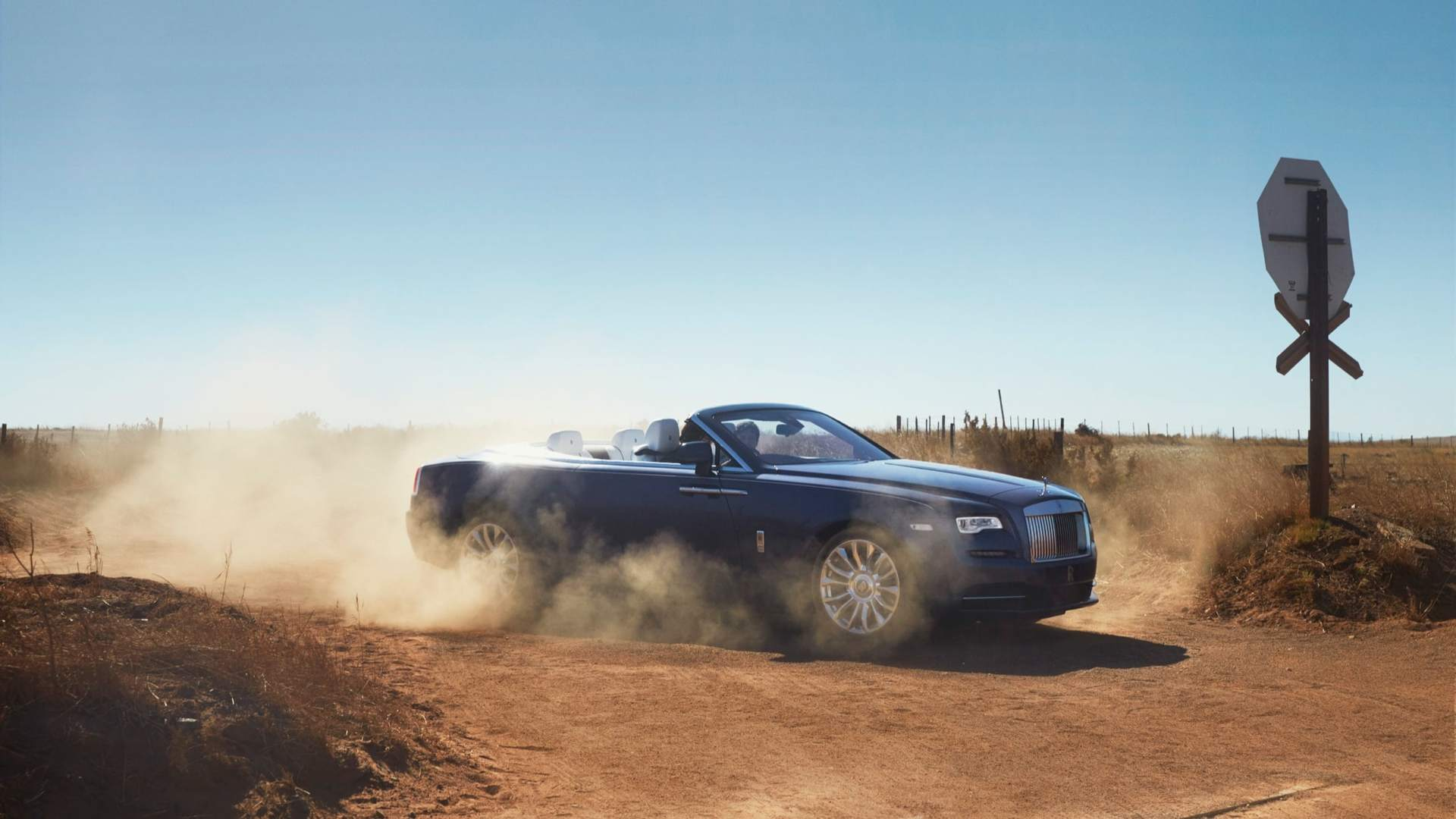 Side view of Rolls-Royce Dawn on a dirt road
