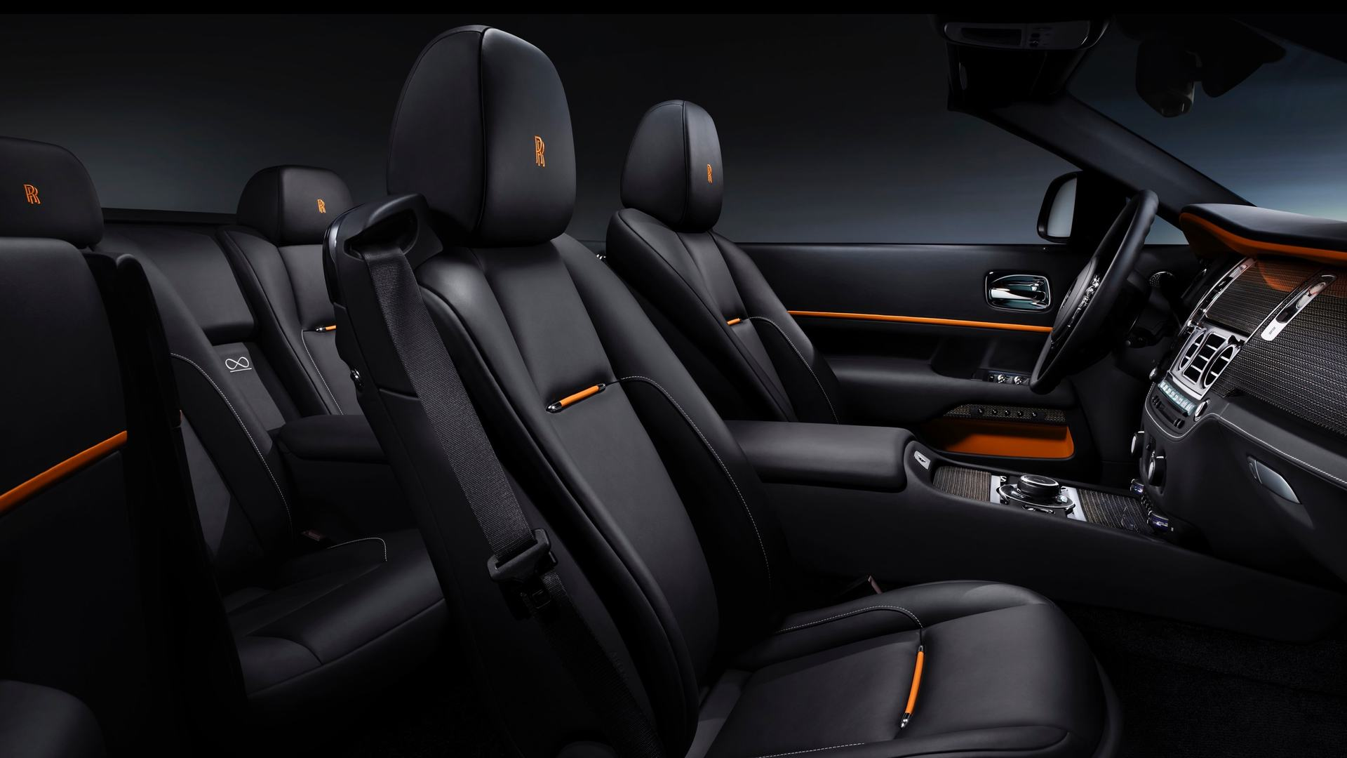 A side shot of a Rolls-Royce Black Badge Dawn showcasing the seats and interior.