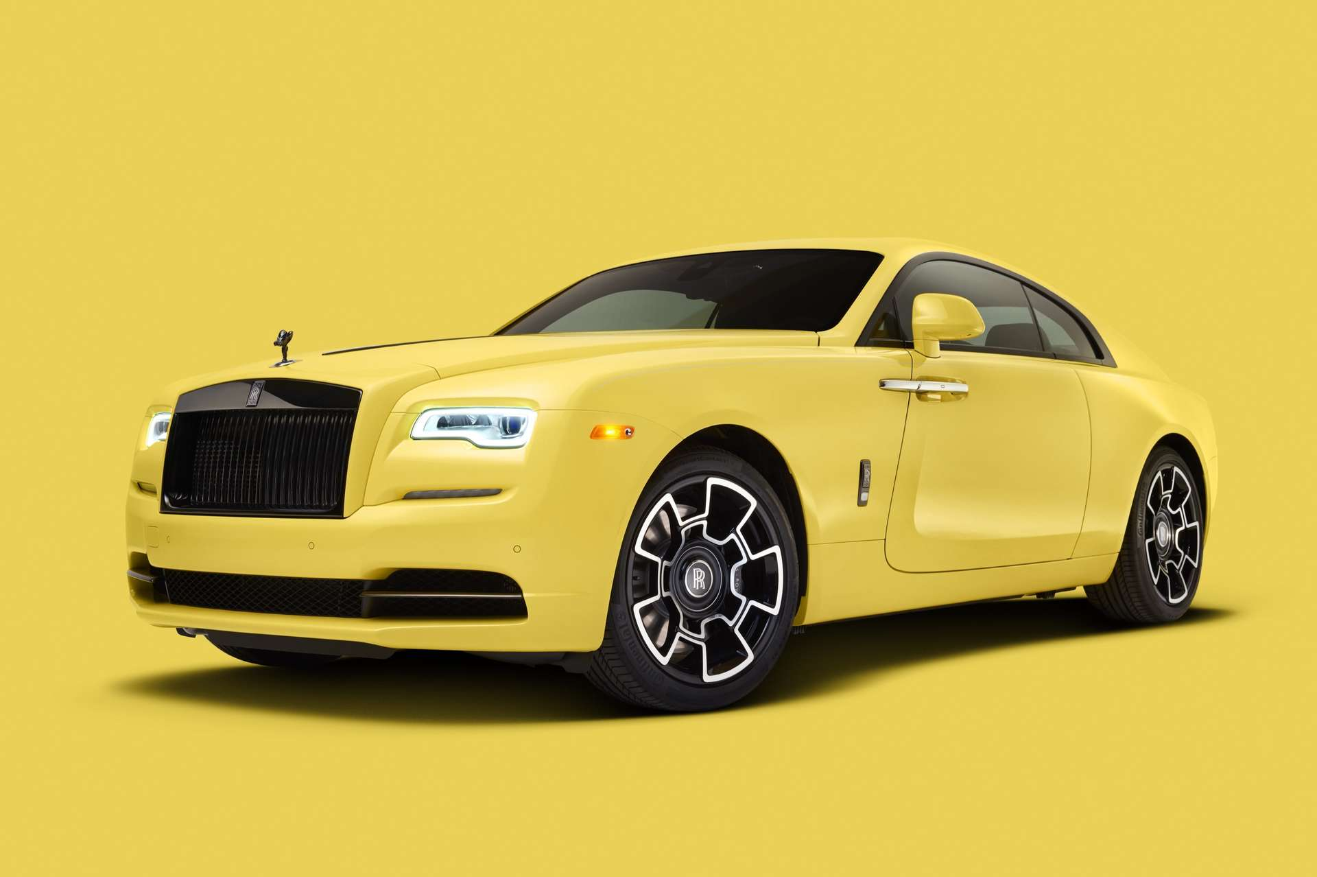 A side view of a Bespoke Pastel Wraith Rolls-Royce Motor Car