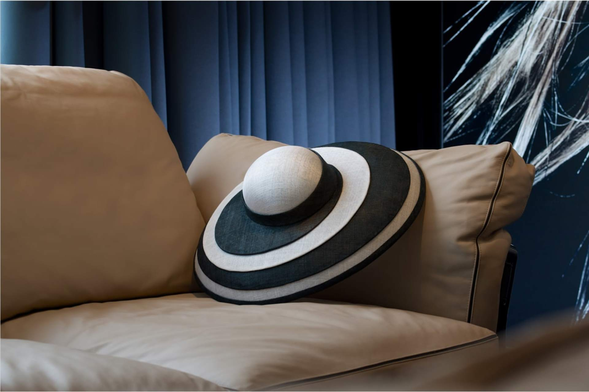 image of rolls-royce trevor morgan hat on a sofa