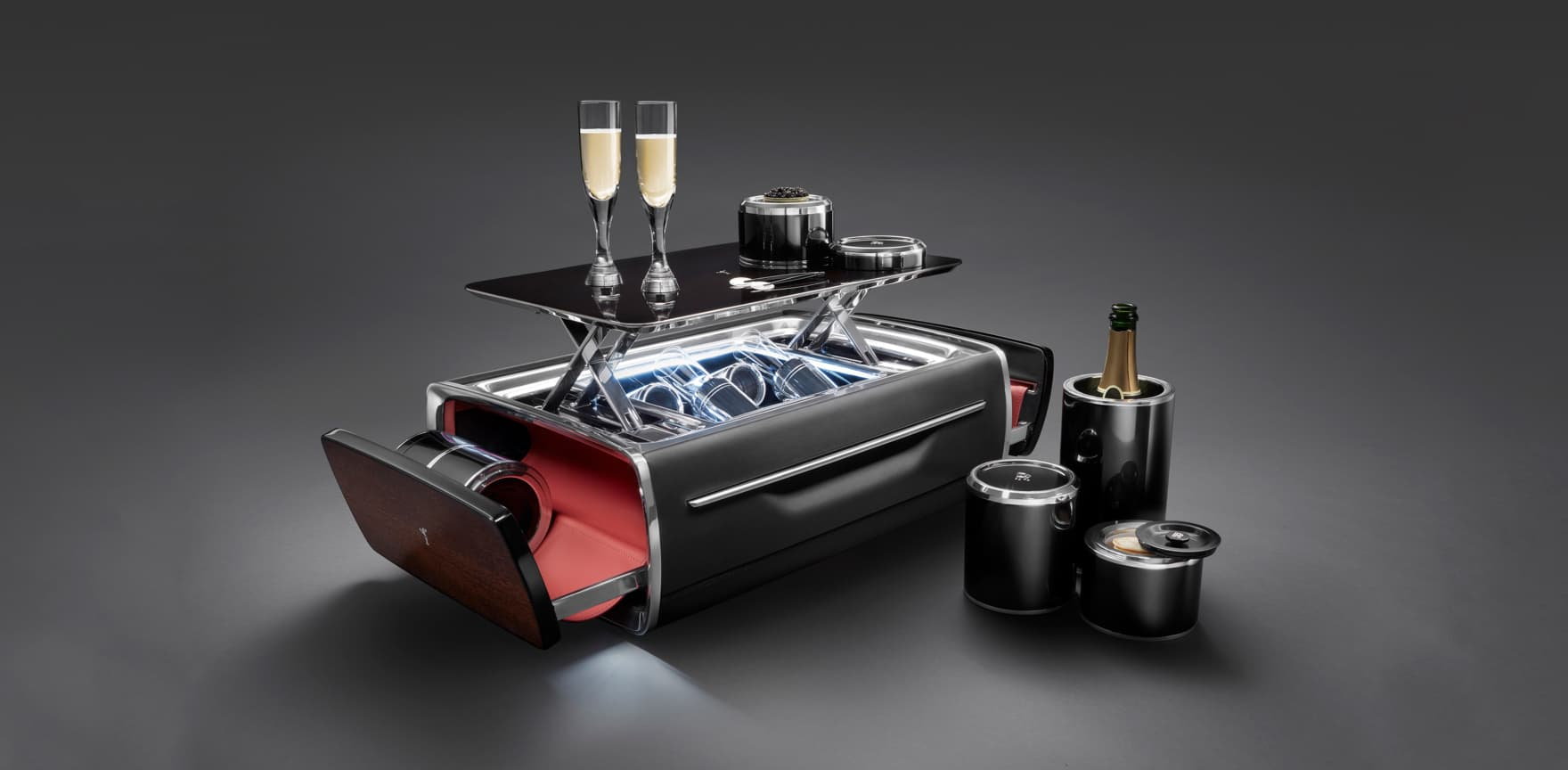 The Rolls-Royce Champagne Chest effortlessly opens at the push of a button to reveal a perfectly appointed champagne set