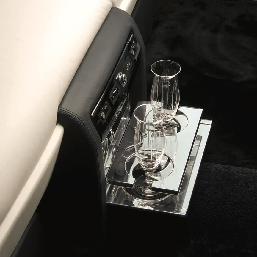 <p>Beautifully engineered, milled and polished from solid aluminium, this dual drinks holder is both practical and stylish. Only available for vehicles with coolbox for lounge seats (please flutes shown in picture are for illustration purposes only, available to purchase separately)</p>