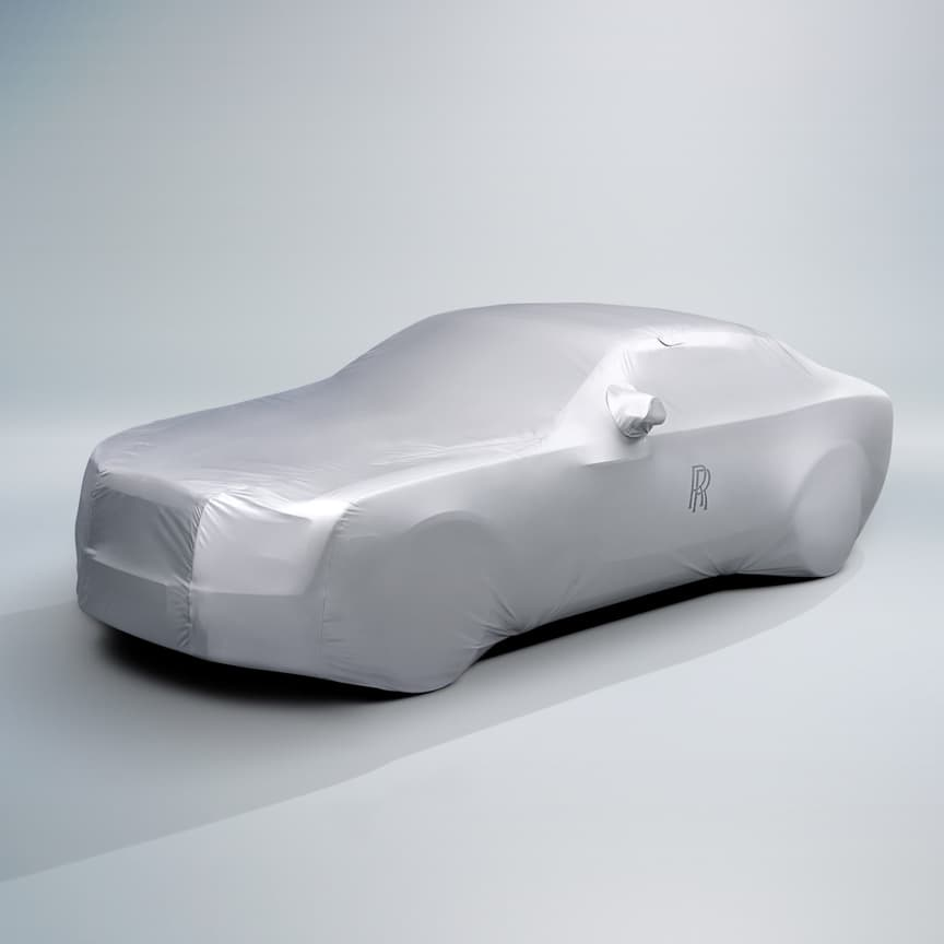 <p>Both breathable and waterproof, this cover preserves the finesse of your Rolls-Royce. Made from high-quality heat-reflective material, it reduces interior temperatures and protects from sun damage and exterior dust. Subtly detailed with the Rolls-Royce monogram, it comes in a coordinating storage bag.</p>