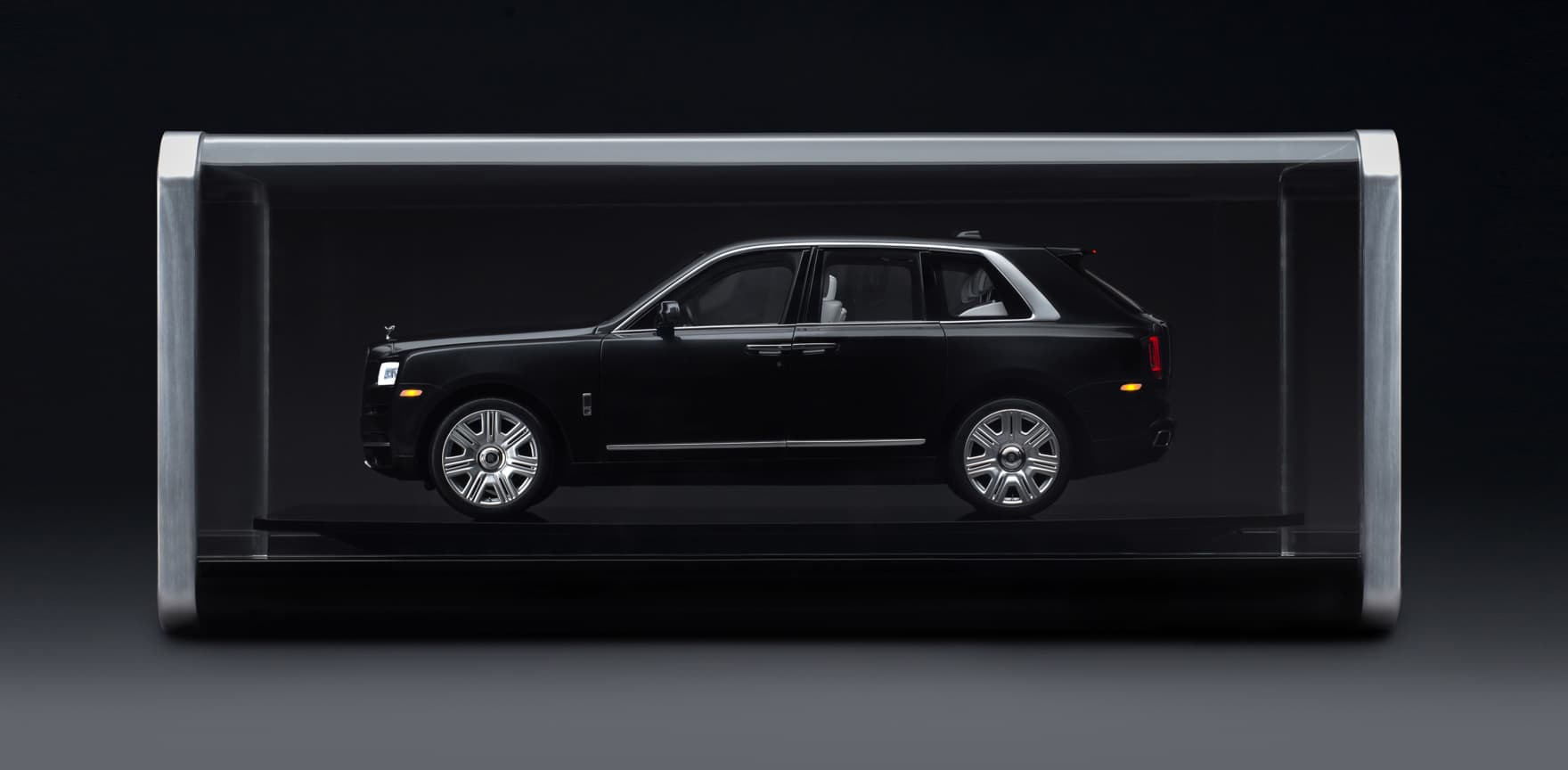 Exterior side view of 1:8 scale model of the Rolls-Royce Cullinan motor car in glass viewing case