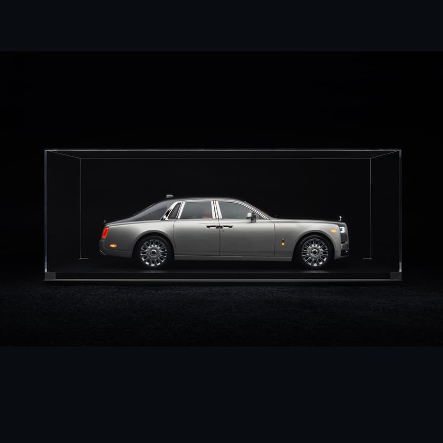 <p>Just as your Rolls-Royce Phantom has a unique and iconic presence, so too do our elegant 1:8 scale models of the range invoke an unmistakable aura. Assembled with thousands of minute components, this Rolls-Royce Phantom is the pinnacle of model reproduction. The result of years of development – with the designers and engineers of our motor cars assisting in its creation – it captures the perfectionism of the marque in miniature form.<br> <br> Hand-finished with the same paint that adorns your own Rolls-Royce Phantom, each model undergoes a scrupulous inspection to ensure superior standards. Only then may it qualify for the iconic Rolls-Royce badge.<br> <br> Choose a replica of your bespoke Rolls-Royce Phantom – or opt for an alternative specification. Either way, the range of 1:8 scale models offers a symbolic enhancement of your Rolls-Royce collection.</p>